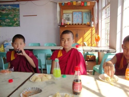 Monks eating Momos
