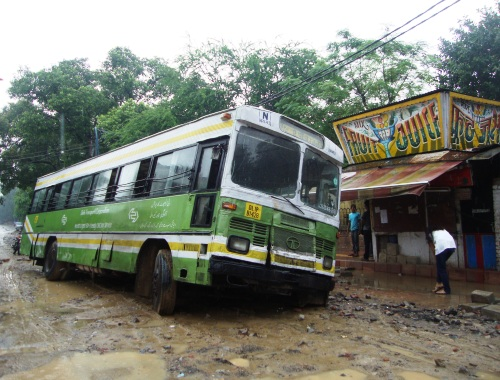 DTC Bus stuck in wet mud