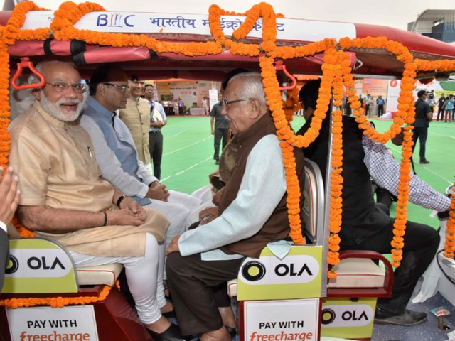 PM Rides eRickshaw to Promote Stand Up India in Letter and Spirit