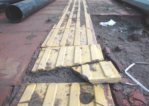Broken footpath tiles
