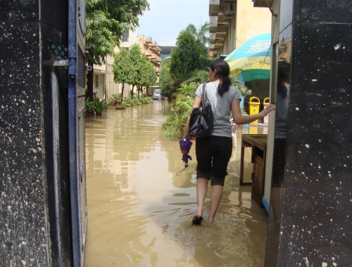 A girl in P.G. Women's Hostel in DU wades through legs deep water