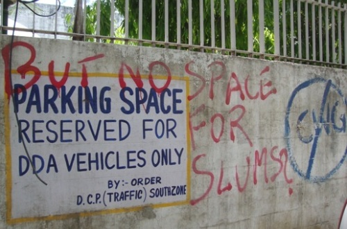 Green Lens: A Thoughtful Graffiti at the DDA Parking Near Siri Fort