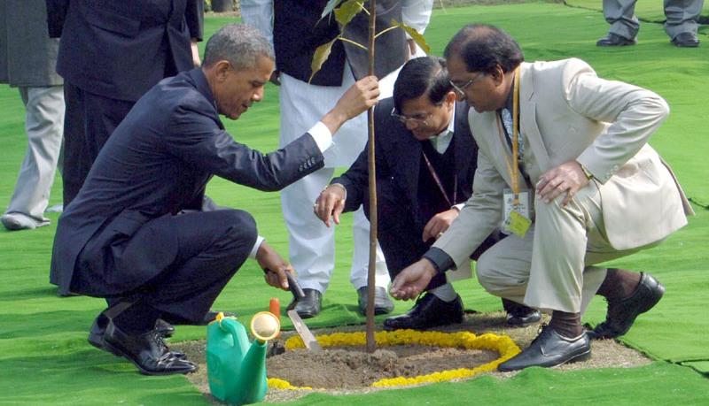 US President Barack Obama Planting a Tree at Rajghat in Delhi